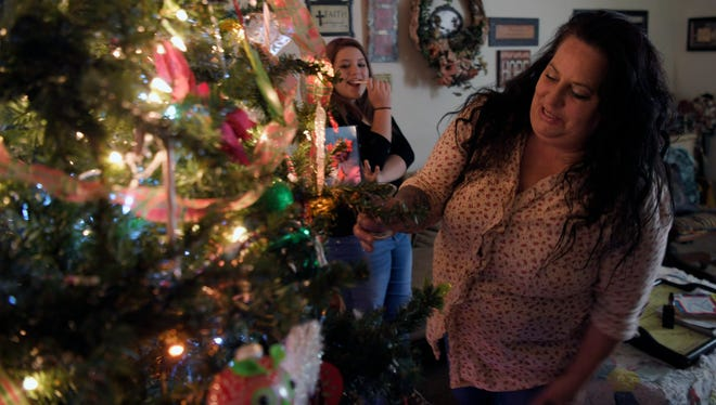 GraceWorks gave Shonna Hall this Christmas tree for her and her daughter Gracie Crumley to have in their Fairview home. Hall works as a cook at Hardees and cleans houses but still needs occasional food boxes and other items from GraceWorks.