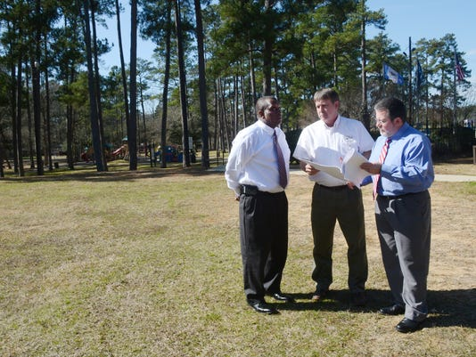 ANI Pineville ProjectsPineville Mayor Clarence Fields (left), public works director Charlie Moore and Rich Dupree, chief of staff look over plans for a splash pad that is going to be built at Kees Park in Pineville. Thursday, Jan. 29, 2015.-Melinda Martinez/mmartinez@thetowntalk.com The Town Talk Gannett
