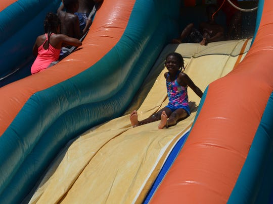 The city of Alexandria's Rec2U summer mobile recreation program features a water slide and many other activities. The program will begin its second year on June 7 at Harmon Park.