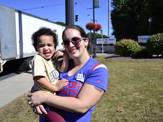 """Allison Johnson, 29, holding her son Damien Johnson, 3, at the 14th annual Blues on the Bridge festival in downtown Binghamton Sunday. """"This is his first year,"""" said Johnson, from Binghamton. """"I wanted to expose him to the music and fun things Binghamton has to offer."""""""