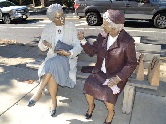 Haddonfield has many public sculptures, some permanent, some on loan to Haddonfield Outdoor Sculpture Trust. Pictured in Seward Johnson's 'Crossing Paths.'