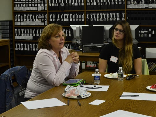 Luann Kida, left, the Community Schools Director for the Broome County Promise Zone, speaks Monday at the first Community Conversation event hosted by Broome Tioga BOCES.