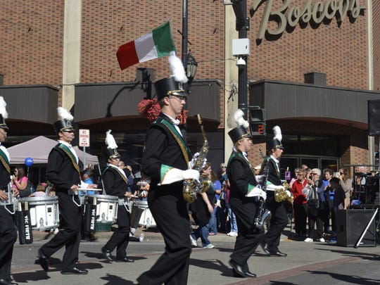 Vestal's marching band performs for crowds during Monday's parade.
