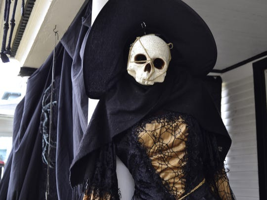 A witch decoration on Linda Caricchio's porch in Binghamton.