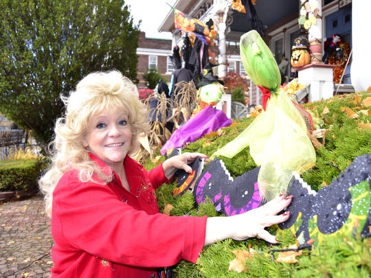 Dee Buckland, a retired social worker, fixes decorations