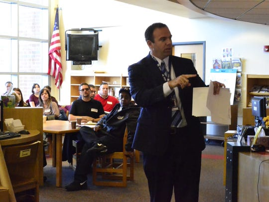 Johnson City Middle School principal Joseph Guccia gives an overview of the school's second VIP Day for 6th grade students Monday, pointing out where they will head after the meeting.