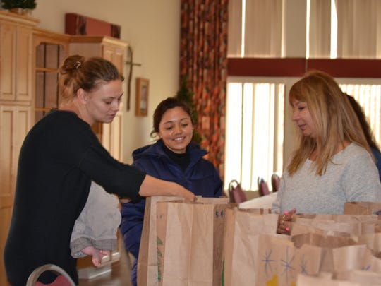 German Helping Hands volunteers prepare personal Christmas gift bags for orphans at Casa Hogar de Bethel Orphanage in Juarez in their church. The group has been preparing gifts for the past seven years.