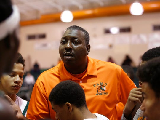 FAMU DRS Head Coach Sean Crowe talks to his team during a timeout in their Regional Quarterfinal game against Christ's Church Academy from Jacksonville on Thursday.