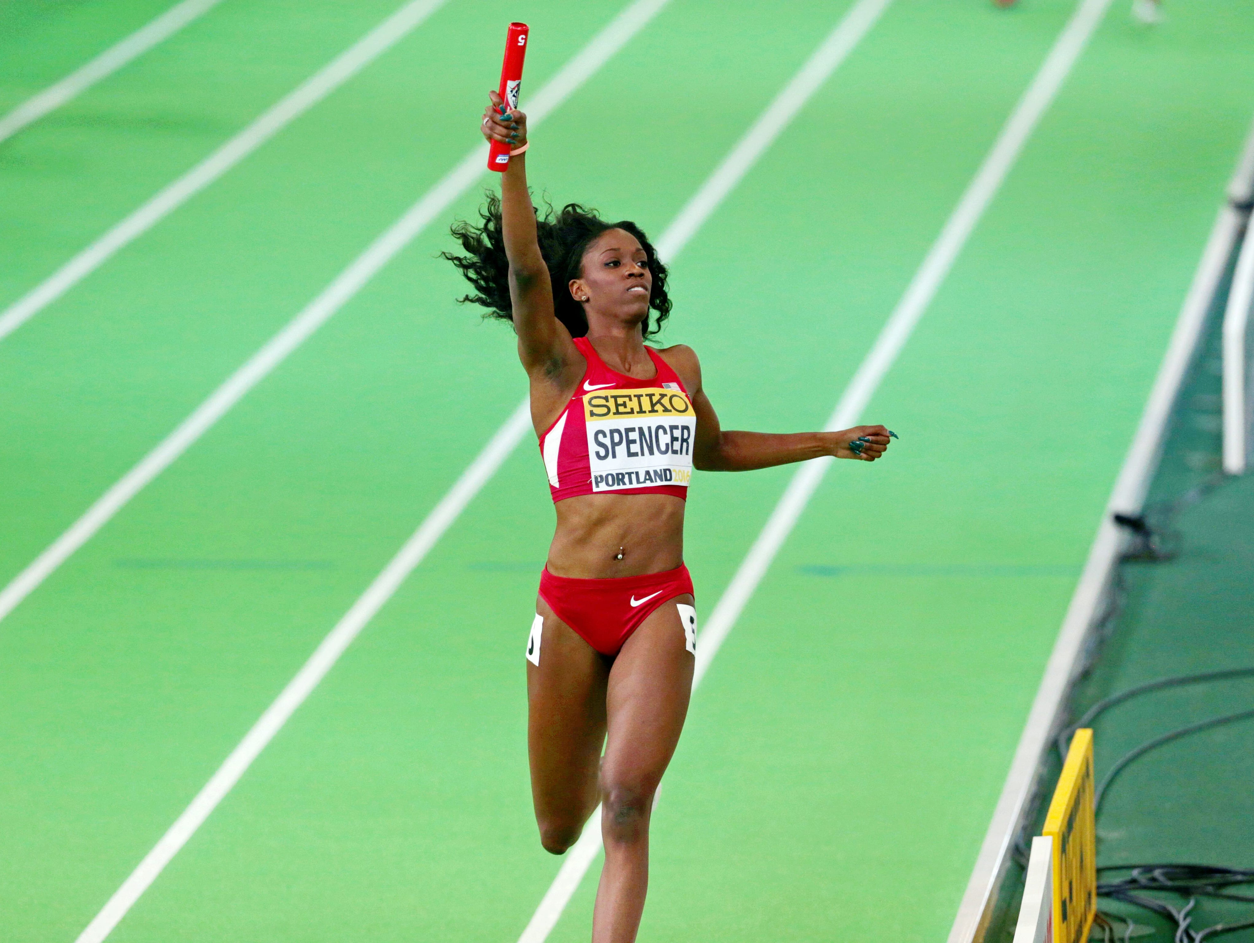 Ashley Spencer USA) win the women's 4x400m relay (3:26.38)at Oregon Convention Center.