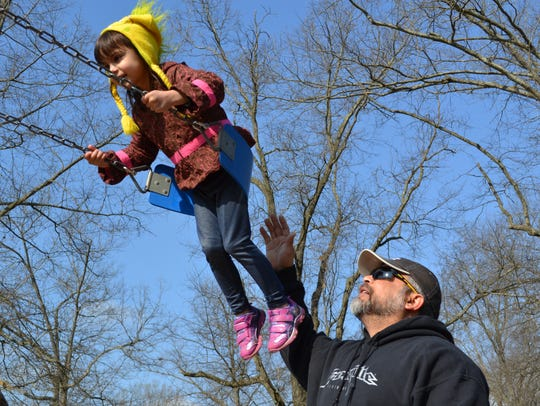 Grace McNulty, 4, flies through the air after the annual