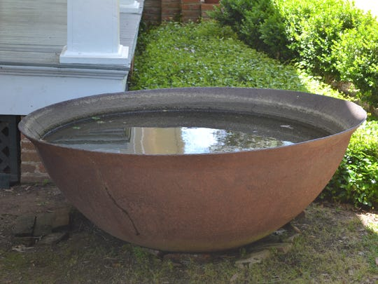 This pot, which sits next to the Chickama house near Lecompte, is a relic from a long-ago sugar operation in the area.