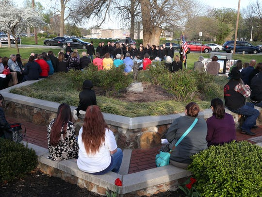 A crowd was gathered at the Memorial Garden in Phelps