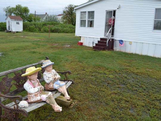 Doris Lee Bradshaw looks out her front door of her