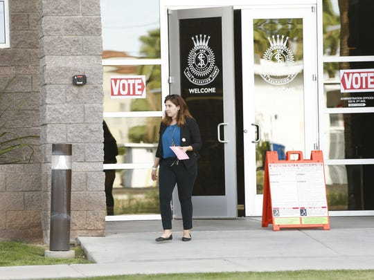 Phoenix resident Courtnay Hough walks out from polling