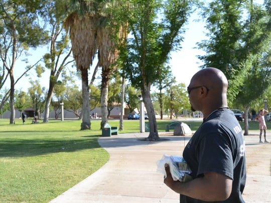 Dewayne McGaughy looks for someone in need to give a bag of necessities to as part of the Coachella Valley Rescue Mission's 90 Days of Summer Relief program in Sunrise Park on Thursday, June 23, 2016. McGaughy, a graduate of the mission who is now employed, was homeless in the same park last year.