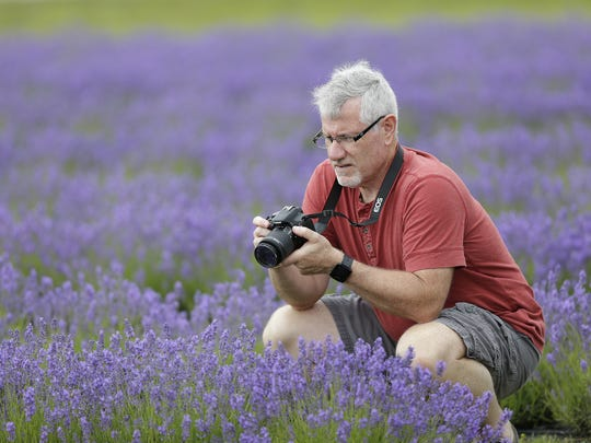 Picturesque fields of lavender at Fragrant Isle Lavender Farm & Shop draw visitors  like Phil Pancrazio of Silvis, Ill., to Washington Island this time of year.