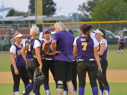 Alexandria Deb's Head Coach D.D. Edwards (center) talks with his players during the championship game at Johnny Downs Sports Complex Wednesday night. The Debs defeated North Carolina 6-3 and 15-3 to claim the Dixie World Series title.