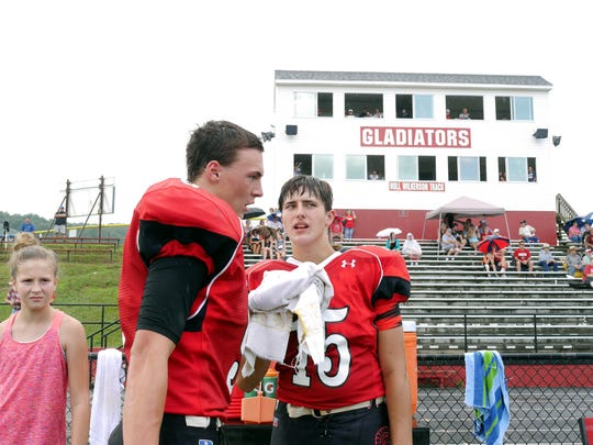 Riverheads playr's #9 Tyler Smith and #15 Casey Phillips on the sidelines during ther scrimmage with Appomattox High School in the Riverheads High School 2016 football jamboree on Aug. 20, 2016.