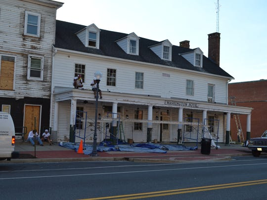 Contractors do exterior work on the old Washington Hotel in Princess Anne. The site, which will soon be called the Washington Inn & Tavern, is due to open in fall 2016.