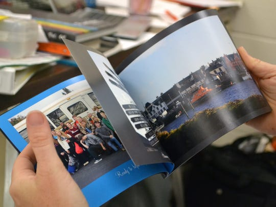 Amy Jennings flips through her photo book of the Stornoway