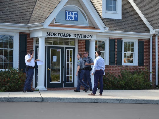 Police investigate an armed robbery at First Shore