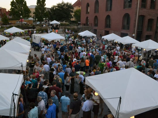 Hundreds gather in downtown Anderson for the annual FreshTaste festival Tuesday night.