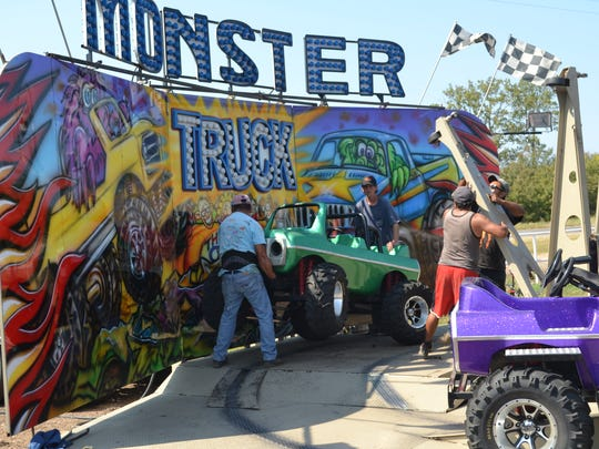 Workers with The Mighty Thomas Carnival position a vehicle for the Monster Truck ride last year as they set up for the Rapides Parish Fair. The 2016 fair begins Wednesday and runs through Sunday,  and the Monster Truck ride will be back again. at the fairgrounds near Louisiana State University of Alexandria.