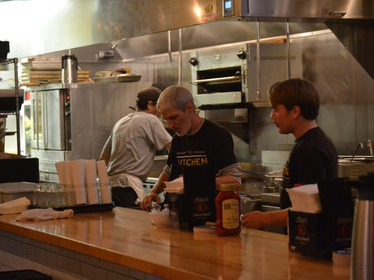 Server Jimmi Studer preps in the evening on Oct. 7 at The Kitchen on Court Street.