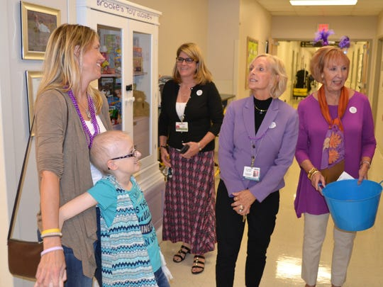 Brooke Mulford and her mother, Amy, chat with Denise Billing, president of the PRMC Foundation, in front of Brooke's Toy Closet at Peninsula Regional Medical Center on Monday, Oct. 17, 2016.