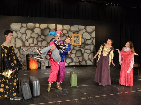 "Brendan O'Dwyer, dressed as a jester, catches a frightened Brian Smith while Sam Lazofsky (far left), Kayla Daurio (second from right) and Sammi Pasterick (far right) look on.  The teenagers star in the high school's play, ""The Worst High School Play In the World,""  which is set for 7:00 p.m. on Nov. 16, Nov. 18 and Nov. 19 in the Main Building auditorium. The cost of tickets is $5 apiece.  The school is located at 4209 Route 516, Matawan."