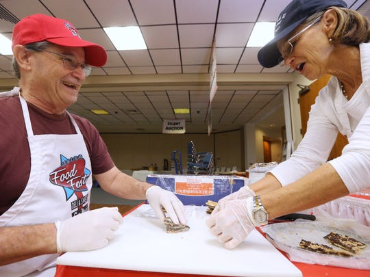 Jim Gold and Amy Krams wrap items for the 2015 Jewish Food Festival. The two-day event returns this year to celebrate 30 years of preserving flavor and tradition.