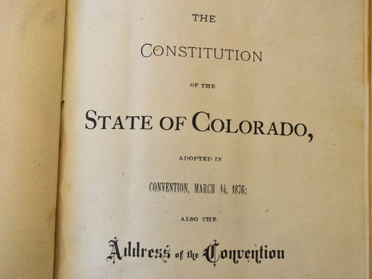 In this Nov. 12, 2016 photo, a close-up of an 1876 copy of the Colorado Constitution which contains an exception under which slavery could be used as punishment for a crime, is shown at the Stephen H. Hart Library & Research Center in Denver. Colorado's voters were asked to eliminate an archaic and offensive reference to slavery as a punishment for a crime in the state Constitution. But a week after the vote, the poorly-written amendment is on the cusp of failing, and a lack of clarity from lawmakers may be to blame. (AP Photo/P. Solomon Banda)