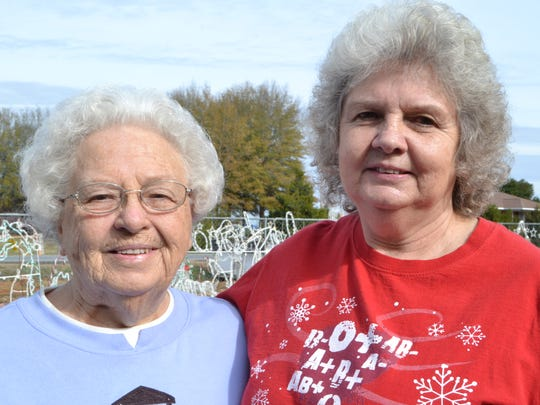 Virginia Campbell stands with her daughter Helen Campbell (right) in her front yard in Westminster.