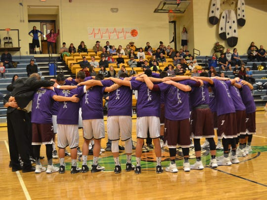 The Tularosa WIldcats and Ruidoso Warriors  basketball teams wore matching Tee shirts while praying for local teen Ella Glass at a recent basketball game and fundraiser in Ruidoso.