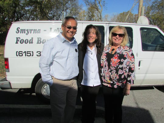 Middle Tennessee Association of Realtors also donated to local food banks in Manchester, Tullahoma, Murfreesboro, Smyrna and La Vergne. Pictured here, left to right: Joe Chittaphong, Parks; Linda Joseph, Smyrna-LaVergne Food Bank warehouse manager; and Virginia Pappafotis, Parks, Smyrna broker.
