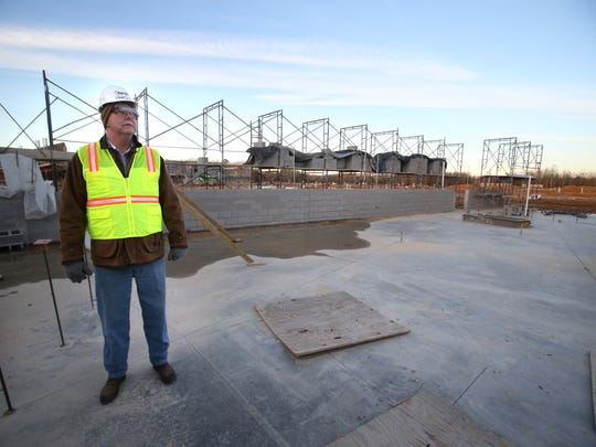 Superintendent John Aitken in the future library and media center at the new Collierville High School under construction.