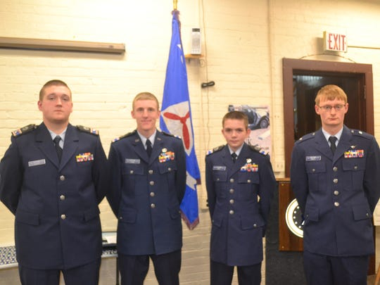 Cadets received the Billy Mitchell Award at a Civil Air Patrol ceremony.