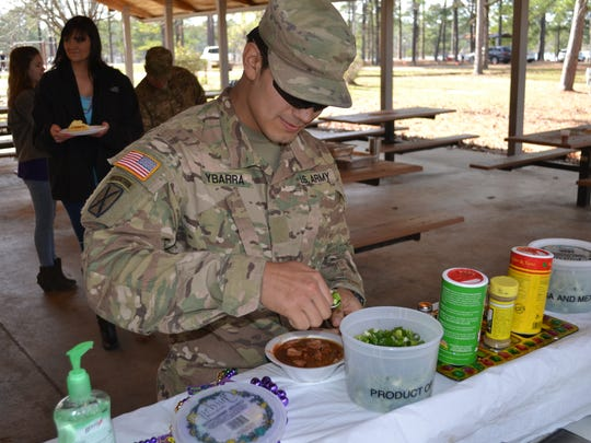 """PFC. Ricardo Ybarra gets his bowl of gumbo. The Corcoran, California, native was at Fort Polk training and had just come in from 14 straight days of training in """"the box."""""""
