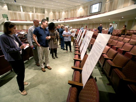 Citizens look at de-annexation study presentation boards during a public input meeting on possible de-annexation held by the city of Memphis at First Assembly of God church in Cordova.