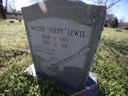 A large marker at the grave of Furry Lewis at Hollywood cemetery was financed by fans.