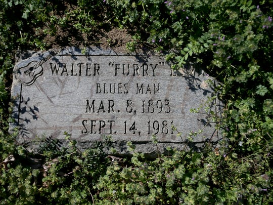 The original flat grave marker of Furry Lewis at Hollywood cemetery.