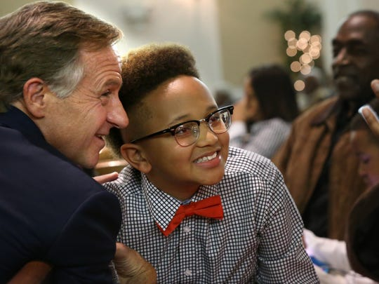 Gov. Bill Haslam poses for a photograph with Downtown Elementary 5th grade student RaShad Jones during a city wide town hall meeting  held at Greater Mount Moriah Baptist Church.