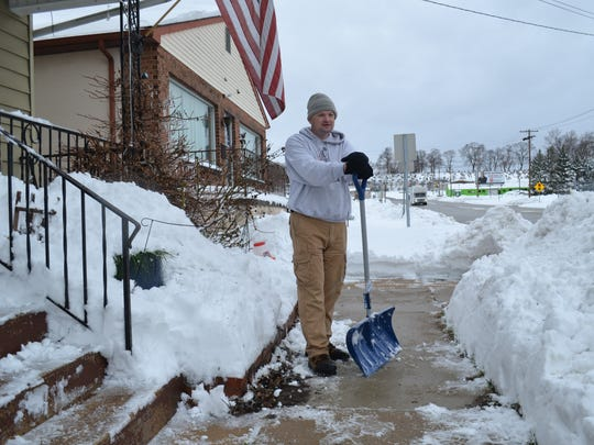 West York resident Thomas Koons takes a break from shoveling snow after winter storm Stella. Koons suffers from epilepsy and hopes to see a York-based company win a permit to build a medical marijuana facility. He believes that medical marijuana will help him to control his seizures.