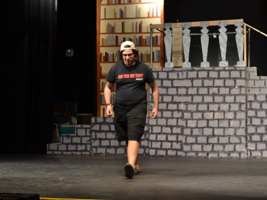 "Joseph Sexson rehearses for the role of the beast in an upcoming production of ""Beauty and the Beast."""