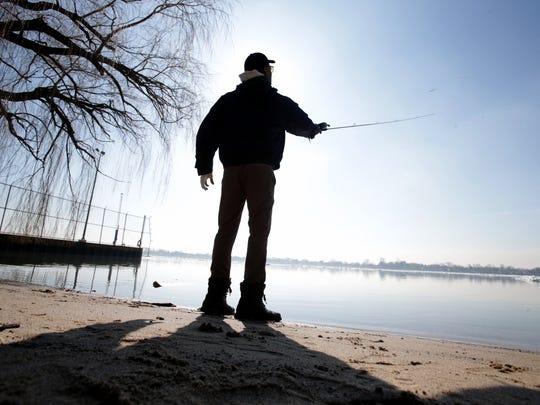 John Roseman, 42, of Farmington Hills casts his rod