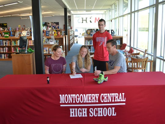 Montgomery Central track star Chloe Harp (seated, center)