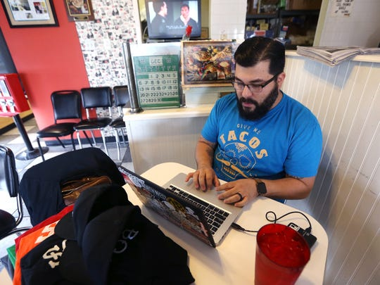 Gerald Flores works on his website at Southside Barbacoa