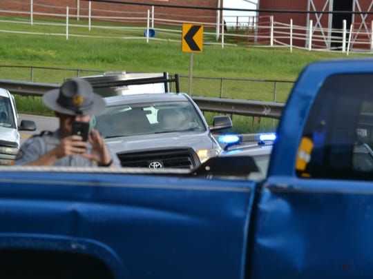 A Highway Patrol officer photographs the scene a fatal wreck at the intersection of Hunt Road and S.C. 8 Tuesday.