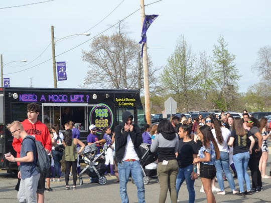 "The Battle of the Classes continued that night with the first Spring Sports & Food Truck Festival, ""Bring the Party Down to Lombardi."""