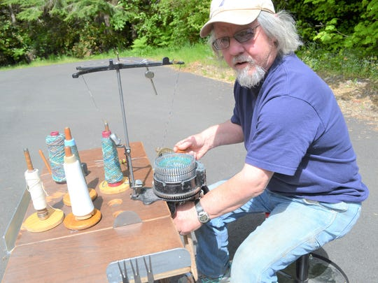 Jim Anderson demonstrates how his 1920s-era sock machine works. Anderson's work will be on display at the annual Harstine Island Art Studio Tour over Memorial Day weekend.